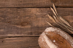 Fresh bread. Rustic bread and wheat on an old vintage planked wood table Stock Photo