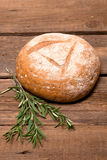 Fresh bread. Rustic bread and wheat on an old vintage planked wood table Royalty Free Stock Photography