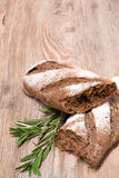 Fresh bread. Rustic bread and wheat on an old vintage planked wood table Royalty Free Stock Photo