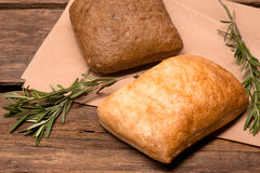 Fresh bread. Rustic bread and wheat on an old vintage planked wood table Royalty Free Stock Image