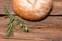 Fresh bread. Rustic bread and wheat on an old vintage planked wood table Stock Image