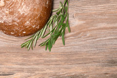 Fresh bread. Rustic bread and wheat on an old vintage planked wood table Royalty Free Stock Images