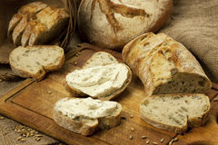 Fresh bread and rye on the wooden board Royalty Free Stock Photos