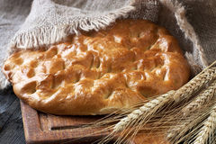 Fresh bread and rye on the wooden board Royalty Free Stock Images