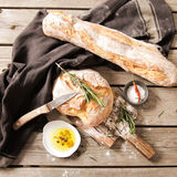 Fresh bread with salt and a delicious olive oil Stock Photography