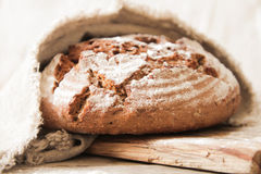 Fresh bread and salt on a wooden background royalty free stock photo