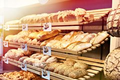 Fresh bread on shelves in bakery stock photo
