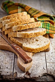Fresh bread slices on wooden board Royalty Free Stock Image
