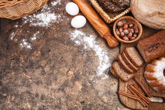 Fresh bread still life bakery product. Top view flour egg plunger on grunge textured background Royalty Free Stock Photo