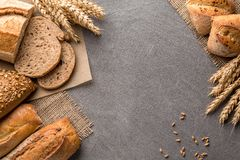 Bread background with wheat, aromatic crispbread with grains, copy space, top view. Brown and white whole grain loaves still life stock photos