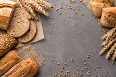 Bread background with wheat, aromatic crispbread with grains, copy space, top view. Brown and white whole grain loaves still life stock photography