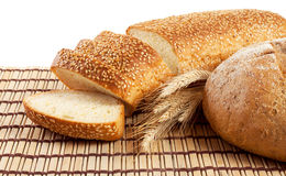 Fresh bread on a straw mat Royalty Free Stock Images