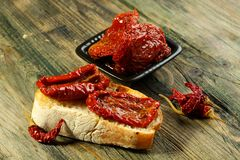 Fresh bread with sun-dried tomatoes. Royalty Free Stock Photography