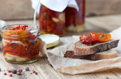 Fresh bread with sun-dried tomatoes on a wooden. Fresh bread with sun-dried tomatoes and garlic on a wooden table Royalty Free Stock Photo
