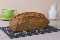 Fresh bread. A fresh sunflower bread on a stone Plate Stock Images