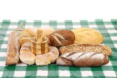 Fresh bread on tablecloth. Royalty Free Stock Images