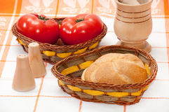 Fresh bread and tomatoes in wicker baskets Royalty Free Stock Image