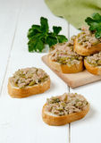 A fresh bread with tuna. Tuna on bread with capers and cornichons Stock Photography