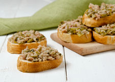 A fresh bread with tuna. Tuna on bread with capers and cornichons Stock Images