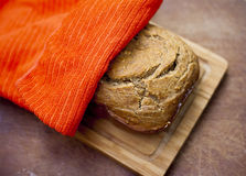 Fresh bread under napkin Royalty Free Stock Image