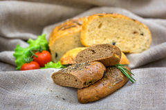 Fresh bread and vegetables  on textiles. Fresh bread and tomato, vegetables  on textiles Royalty Free Stock Images