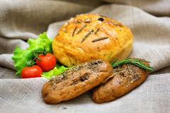 Fresh bread and vegetables  on textiles. Fresh bread and tomato, vegetables  on textiles Stock Photo