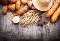 Fresh bread and wheat. On black background stock photos
