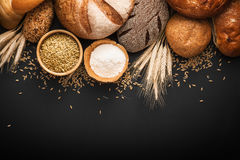 Fresh bread and wheat. On black background royalty free stock photos