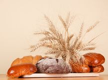 Fresh bread and wheat ears Royalty Free Stock Photos