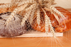 Fresh bread and wheat ears Royalty Free Stock Images