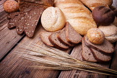 Fresh bread and wheat ears Royalty Free Stock Photo