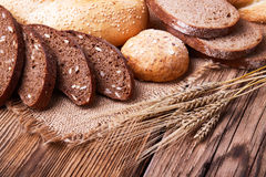 Fresh bread and wheat ears Stock Photos