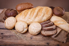 Fresh bread and wheat ears Stock Photo