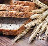 Fresh bread with wheat ears Stock Photography