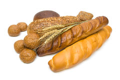 Fresh bread and wheat ears on white background. Fresh bread and wheat ears isolated on white background close-up. horizontal photo royalty free stock photography