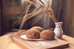 Fresh bread and wheat ears Stock Image