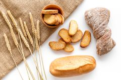 Fresh bread with wheat flour in bakery shop on white desk background top view Stock Photos