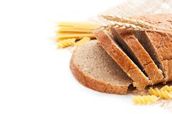 Fresh bread with wheat spikes and macaroni Royalty Free Stock Photo