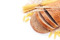 Fresh bread with wheat spikes and macaroni Stock Photography