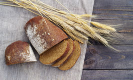 Fresh bread and wheat on the table. Top view stock photos