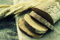 Fresh bread and wheat on the table Stock Photos