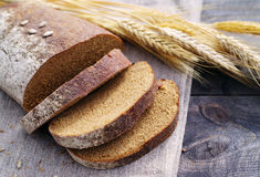 Fresh bread and wheat on the table Stock Photo