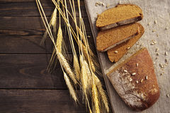 Fresh bread and wheat on the table Stock Images