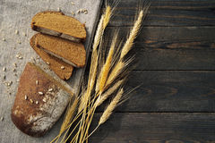 Fresh bread and wheat on the table Stock Image