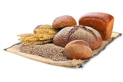 Fresh bread  and wheat. On the white background Royalty Free Stock Photo