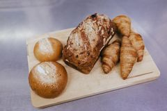 Fresh bread and wheat on the wooden. Bakery indoors concept. food and drink royalty free stock photos