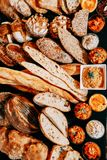 Fresh bread and rolls. Fresh bread and wheat on the wooden royalty free stock images