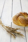 Fresh bread and wheat on wooden background Stock Photos