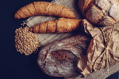 Fresh bread and wheat on the wooden - Image. Fresh bread and wheat on the black wooden - Image royalty free stock photos