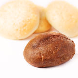 Fresh bread on a white background. Buns in a basket on a white background Stock Photos